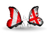 Butterflies with Peru and Georgia flags — Stock Photo