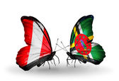 Butterflies with Peru and Dominica flags — Stock Photo