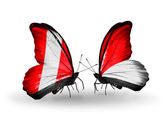 Butterflies with Peru and Monaco, Indonesia  flags — Stock Photo