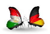 Butterflies with  Tajikistan and Germany flags — 图库照片