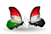 Butterflies with  Tajikistan and Yemen flags — Stock Photo