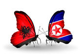 Butterflies with Albania and  North Korea flags — Stock Photo