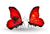 Butterflies with Albania and  China flags — Stock Photo