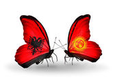 Butterflies with Albania and  Kirghiz flags — Stock Photo