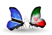 Butterflies with Botswana and Iran flags — Stock Photo