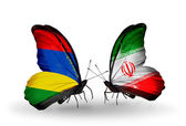 Butterflies with Mauritius and  Iran flags — Stockfoto