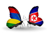 Butterflies with  Mauritius and  North Korea flags — Stock Photo