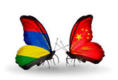 Butterflies with  Mauritius and  China flags — Stock Photo