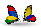 Butterflies with Mauritius and  Columbia flags — Stok fotoğraf