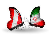 Butterflies with Peru and Iran flags — Stock Photo