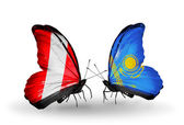 Butterflies with Peru and Kazakhstan flags — Stock Photo
