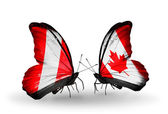 Butterflies with  Peru and Canada flags — Stock Photo