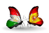 Butterflies with Tajikistan and Spain flags — Stock Photo