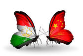 Butterflies with Tajikistan and China flags — Stok fotoğraf
