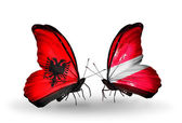 Butterflies with Albania and Latvia flags — Stockfoto