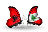 Butterflies with Albania and Lebanon flags — Stock Photo