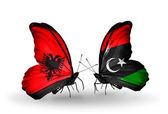 Butterflies with  Albania and Libya flags — Stok fotoğraf