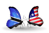 Butterflies with Botswana and Liberia flags — Stockfoto