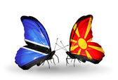 Butterflies with Botswana and Macedonia flags — Stok fotoğraf