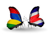 Butterflies with Mauritius and Costa Rica flags — Stock Photo