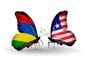 Butterflies with Mauritius and Liberia flags — Stockfoto