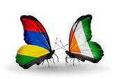 Butterflies with  Mauritius and Cote Divoire flags — Stock Photo