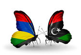 Butterflies with Mauritius and Libya flags — Stockfoto