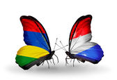 Butterflies with Mauritius and Luxembourg flags — Stockfoto