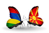 Butterflies with Mauritius and Macedonia flags — Stockfoto