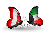Butterflies with Peru and Kuwait flags — Stok fotoğraf