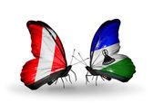 Fjärilar med peru och lesotho flaggor — Stockfoto