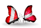 Butterflies with Peru and Latvia flags — Stockfoto