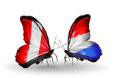 Butterflies with Peru and Luxembourg flags — Stockfoto