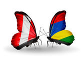 Butterflies with Peru and Mauritius flags — Stockfoto