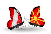Butterflies with Peru and Macedonia flags — Stockfoto