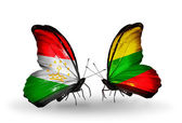 Butterflies with  Tajikistan and Lithuania flags — Stock Photo