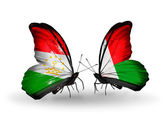 Butterflies with Tajikistan and Madagascar flags — Stockfoto