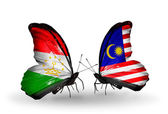 Butterflies with Tajikistan and Malaysia flags — Stockfoto