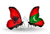 Butterflies with Albania and Maldives flags — Stock Photo