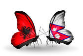 Butterflies with Albania and Nepal flags — Stockfoto