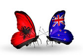 Butterflies with  Albania and New Zealand flags — Stockfoto