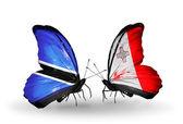 Borboletas com bandeiras botswana e malta — Foto Stock