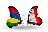 Butterflies with  Mauritius and Malta flags — Stock Photo