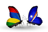 Butterflies with Mauritius and Marshall islands flags — Stock Photo