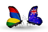 Butterflies with  Mauritius and  New Zealand flags — Stockfoto