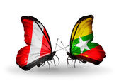 Butterflies with Peru and Myanmar flags — Stok fotoğraf