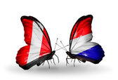 Butterflies with Peru and Holland flags — Zdjęcie stockowe