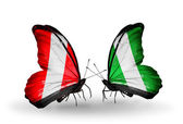 Butterflies with Peru and  Nigeria flags — Stock Photo