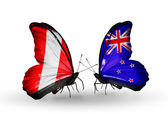 Butterflies with Peru and New Zealand flags — Stock Photo