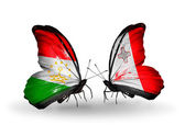 Butterflies with Tajikistan and Malta flags — Stock Photo
